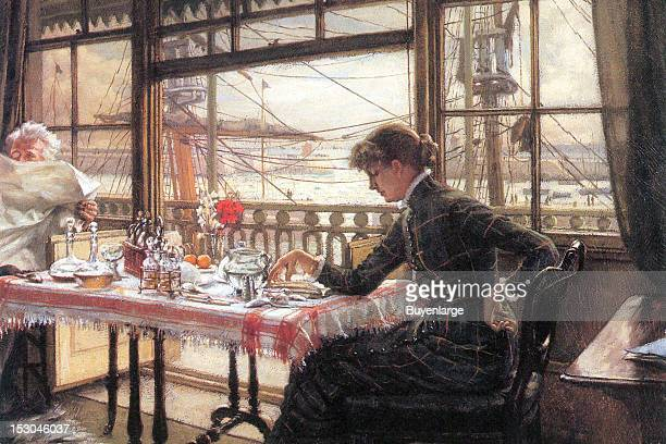 A young woman has breakfast at a table with a window that overlooks a harbor a man sits across from her reading a newspaper 1865 By James Tissot