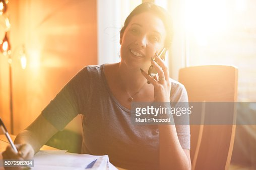 Young woman has some good news on the phone.