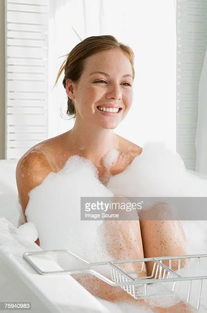 Young woman having a bubble bath