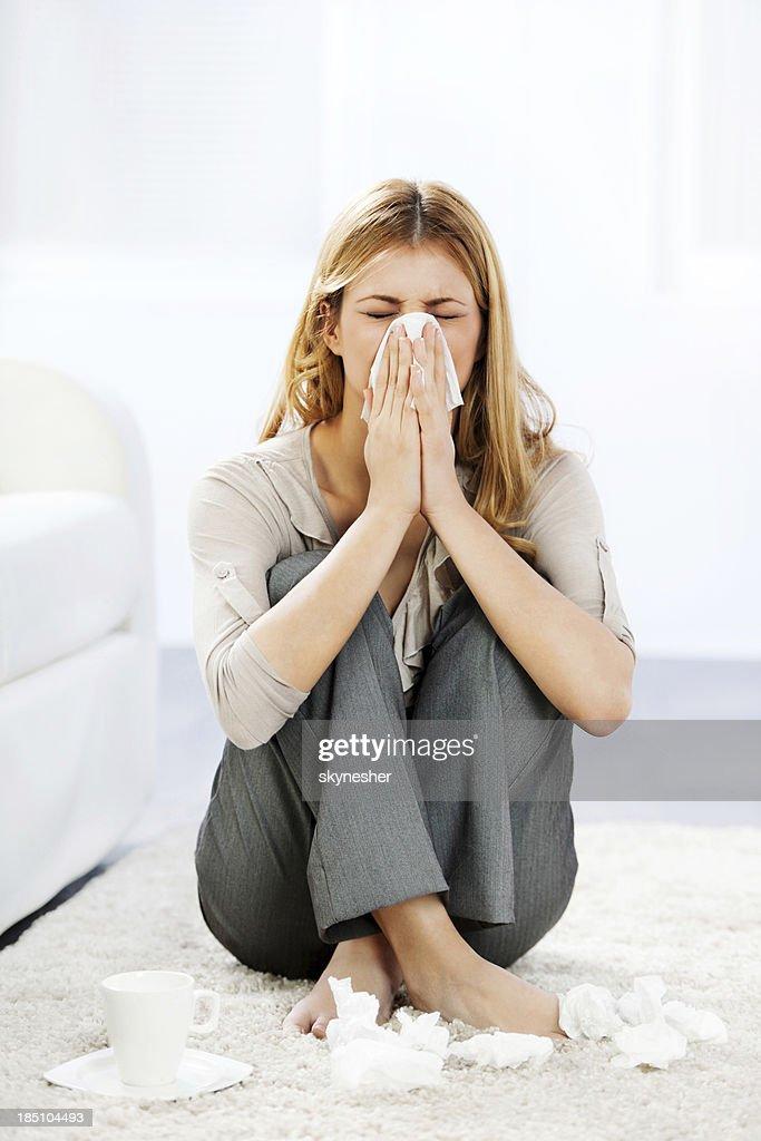 Young woman having a flu.