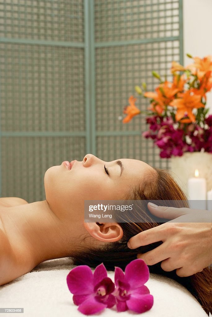 Young woman having a head massage : Stock Photo