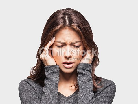 Young woman having a headache : Stock Photo