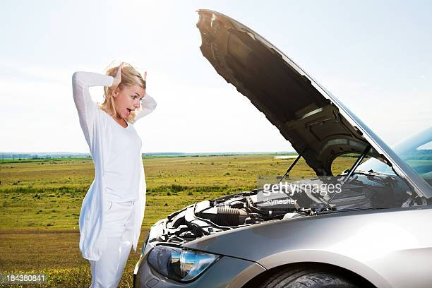 Young woman having a headache when her car broke down.