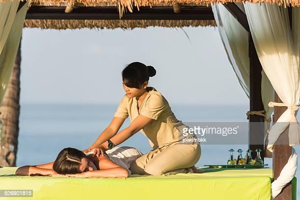Young woman having a massage under a gazebo
