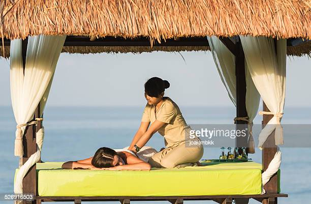 Young woman having a massage under a gazebo