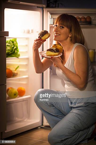 Young woman having a midnight snack