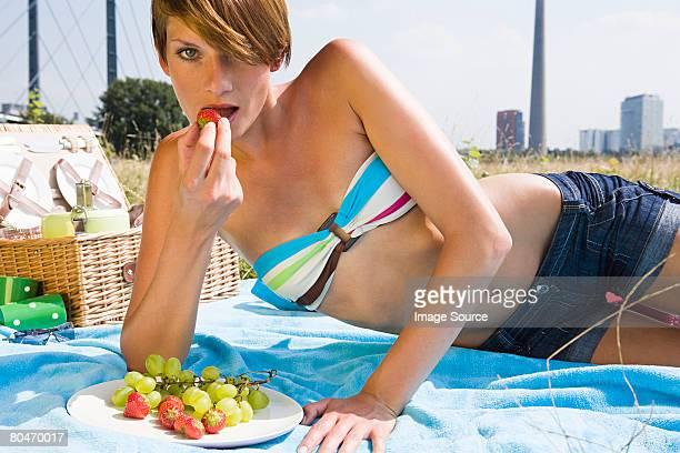 Young woman having a picnic
