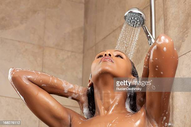 Young woman having a shower.