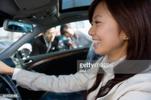 A Young Woman Having a Test Ride
