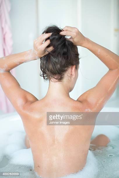 Young woman having bath