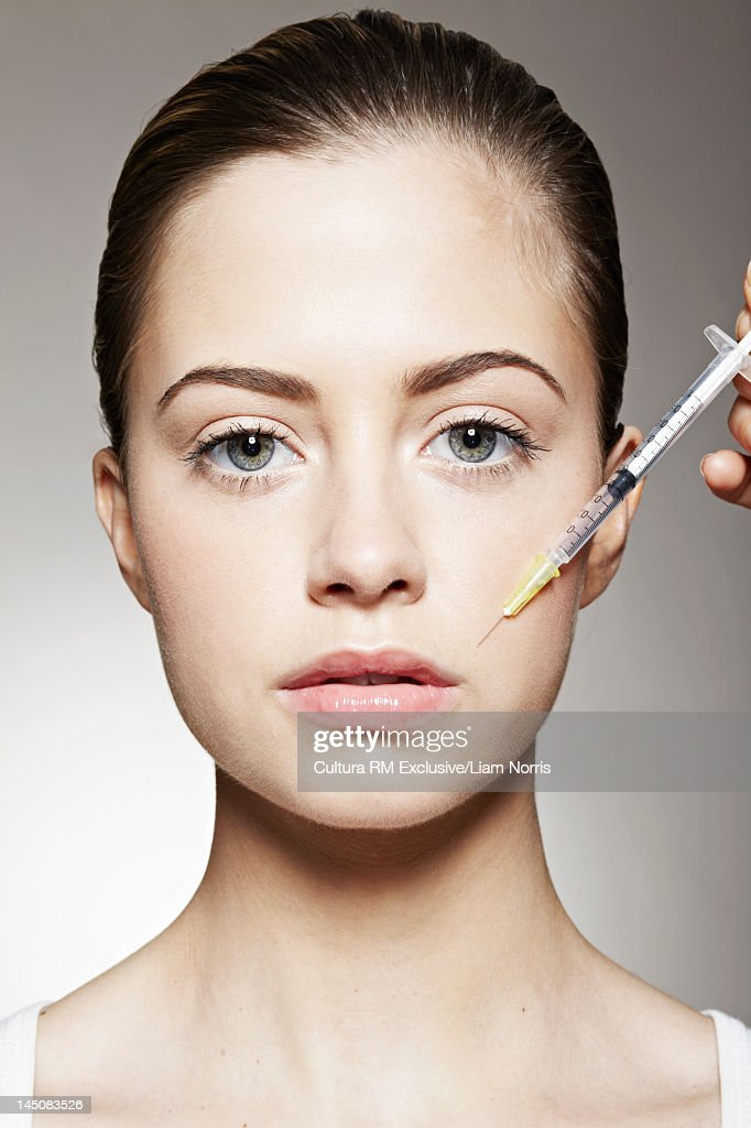Young woman having botox injection