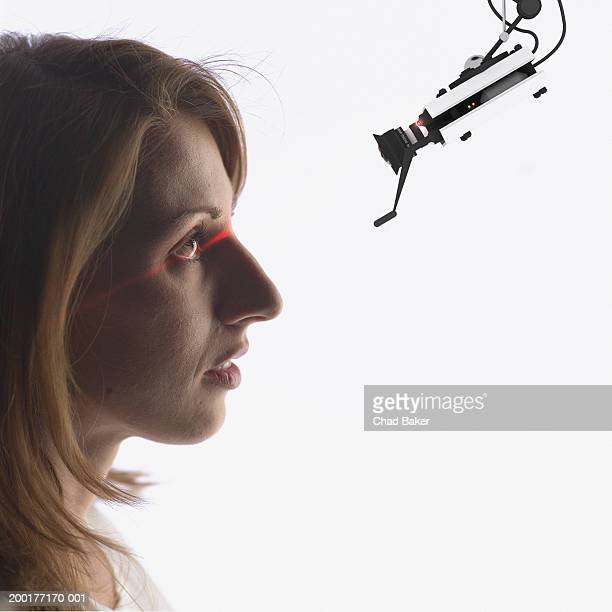 Young woman having eye scanned  (Digital Composite)
