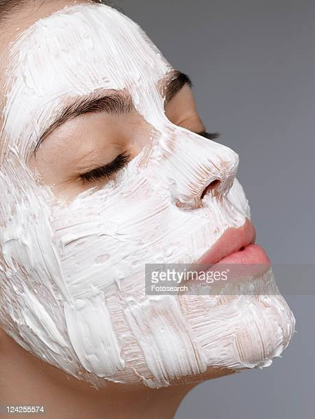 Young woman having face mask