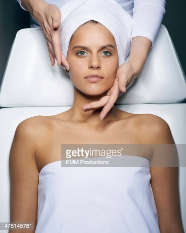 Young woman having facial treatment