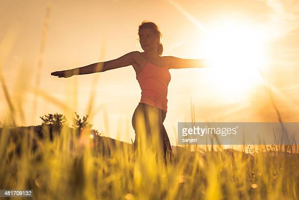 Young woman having fitness training in nature