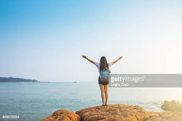 Young woman having fun by sea