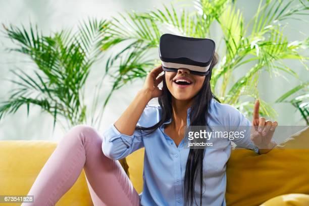 Young woman having fun during virtual reality exploration