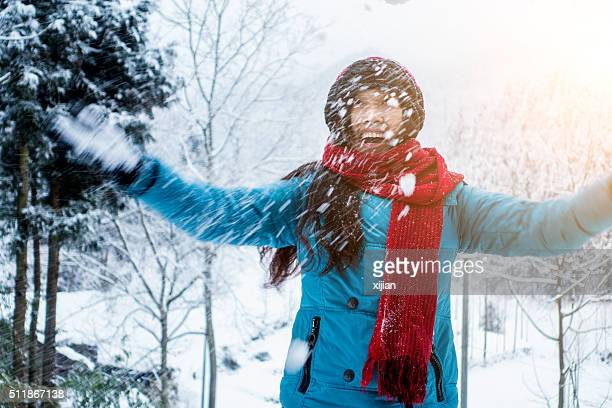 Young woman having fun in winter