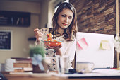 Young woman having lunch break