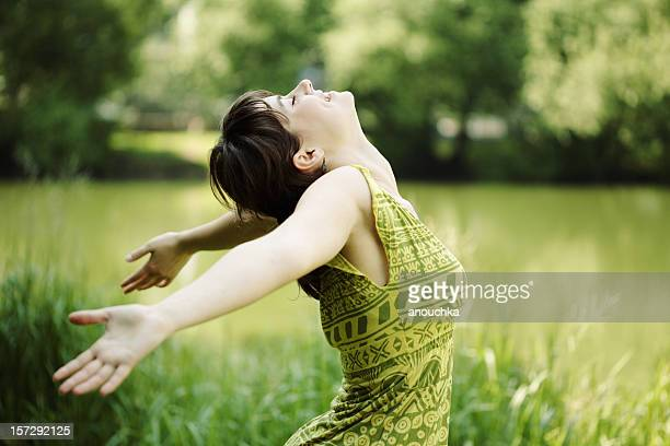 Young woman, her face upward, enjoying the sun