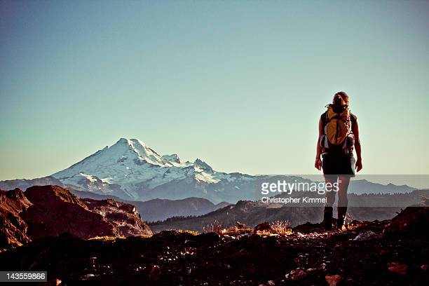 Young woman hiker looking at Mt. Baker