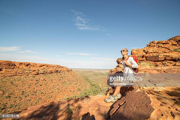 Young woman hiking at the Kings Canyon, Australia