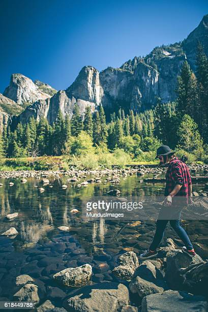 Young woman hiking in majestic landscape