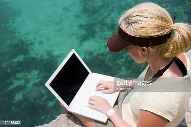 Blond Young Woman Using Laptop Outdoors, Copyspace