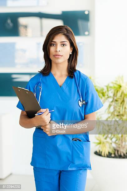 Young Woman Hispanic Doctor Nurse in Office