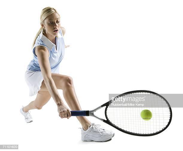 Young woman hitting a tennis ball