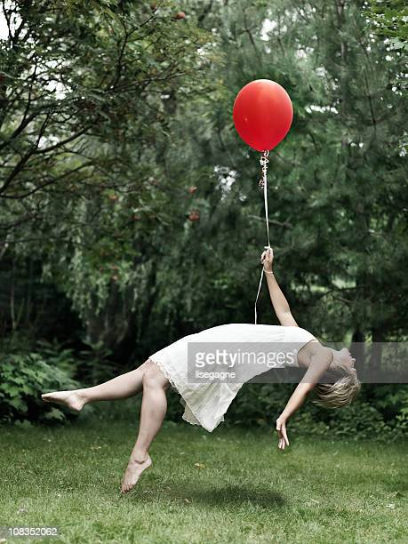 Young woman holding a balloon