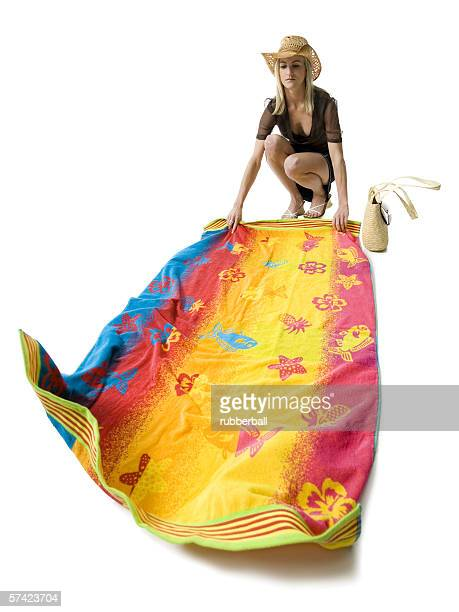 Young woman holding a beach towel