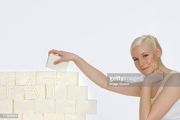 Young woman holding a block of lard