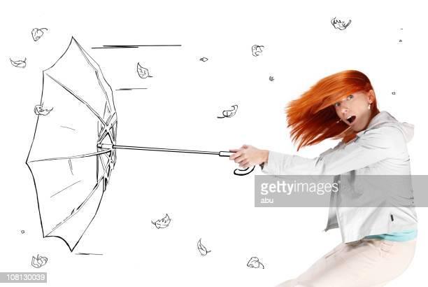 Giovane donna con un fumetto vento soffiato ombrello