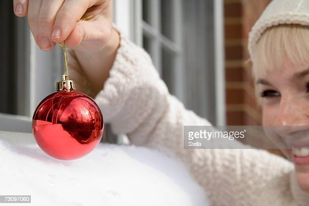 Young woman holding a Christmas bauble