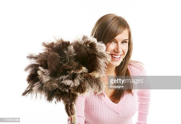 Young woman holding a feather duster