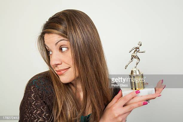 Young woman holding a trophy