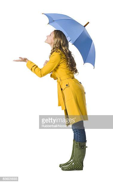 young woman holding an umbrella.
