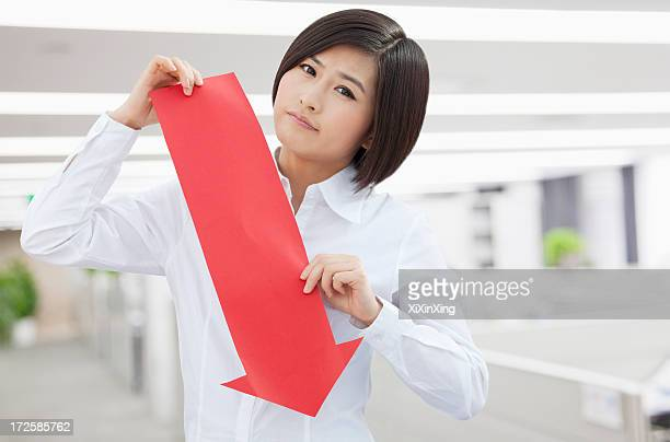 Young Woman Holding Arrow Sign Paper Cut