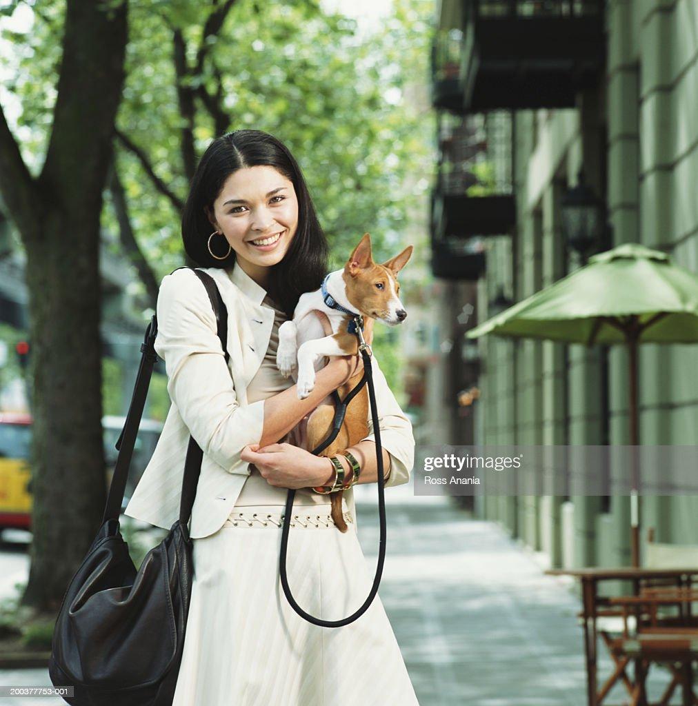 Young woman holding   Basenji dog : Stock Photo
