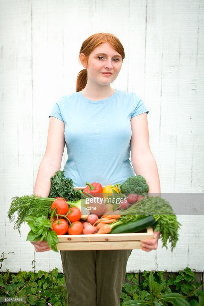 Young Woman Holding Basket of Fresh Garden Vegetables : Stock Photo