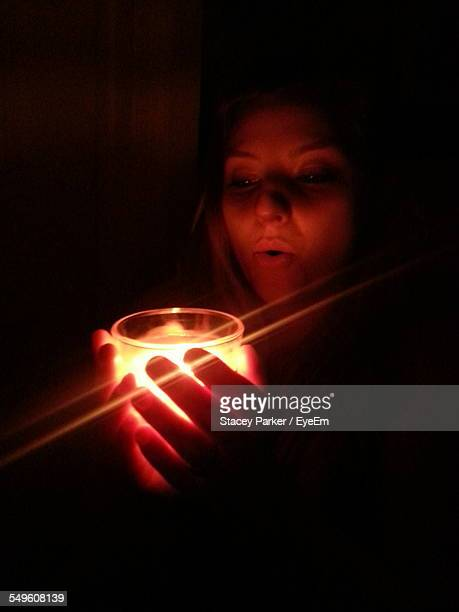 Young Woman Holding Candle