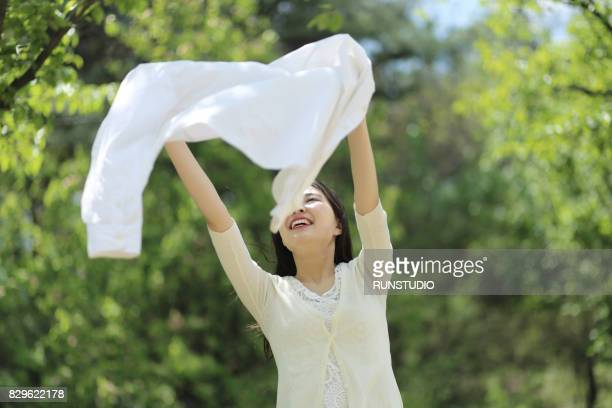 young woman holding clean laundry