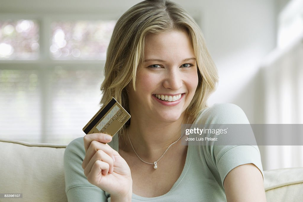 Young woman holding credit card : Stock Photo