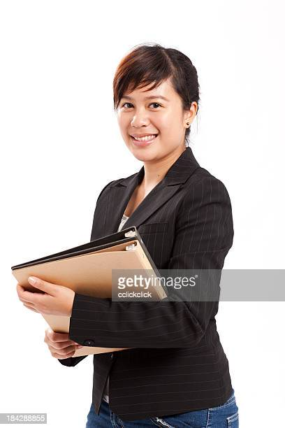 Young woman holding files