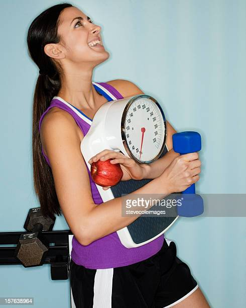 Young Woman Holding Fitness Equipment