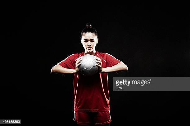 Young woman holding football