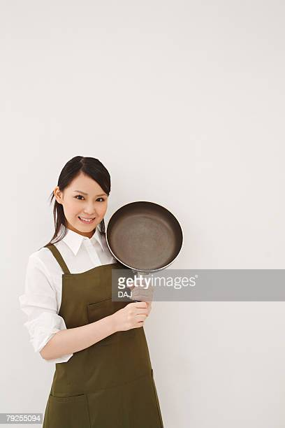 Young Woman Holding Fry Pan