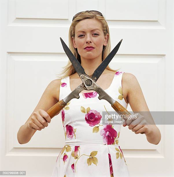 Young woman holding garden shears, portrait
