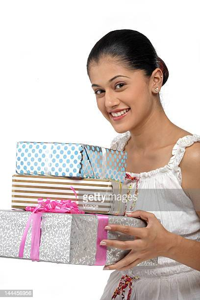 Young woman holding gift boxes